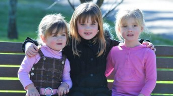 PLAYTIME: Eleanor Roberts, Grace Dickinson and Abigail Roberts are encouraging people to get behind the 2014 Playtime Pictures photo competition to raise funds forCerebral Palsy Alliance