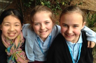 Three girls smiling as they embark on STEptember