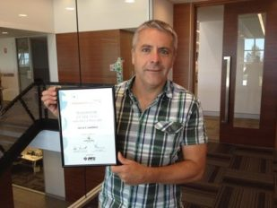 Mick Campbell holding certificate