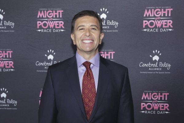 Vince Sorrenti standing in front of Might And Power promotional board