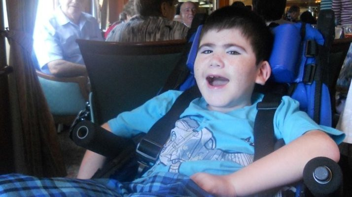boy in wheelchair smiling at camera