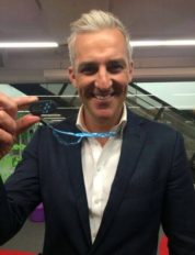 Dr Andrew Rochford showing his pedometre hung around his neck