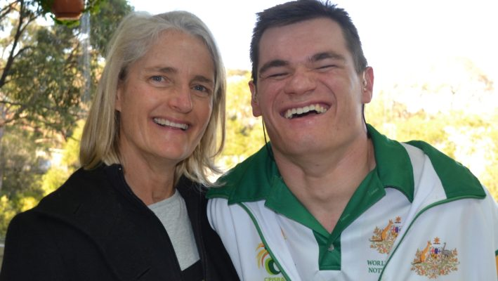 mother and grown up son who is wearing an Australian team tracksuit