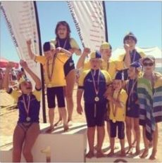 Children with medals standing on a podium