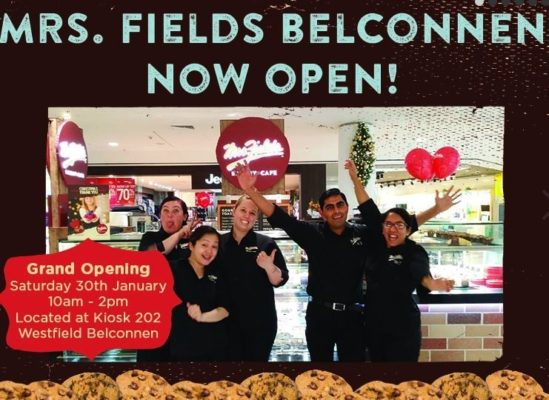 five Mrs Fields cookie staff standing outside store to promote opening of new store in Belconnen, ACT, Australia