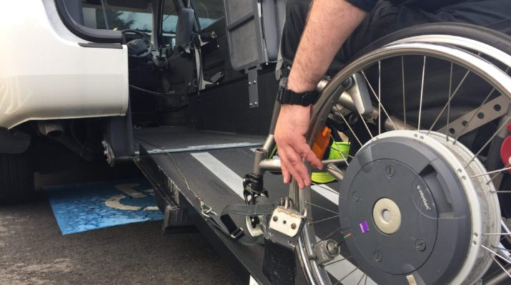 man in wheelchair on ramp into accessible vehicle