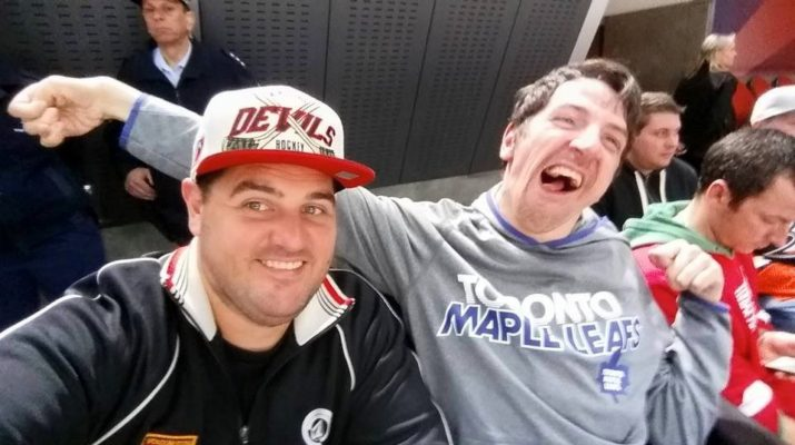 Brothers Gavin and Glen at a sports game. Glen has cerebral palsy.