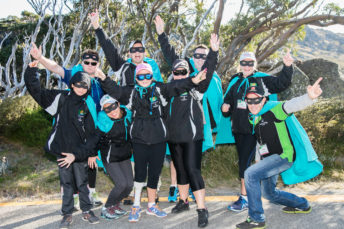 Krazy Kosci Klimb participants - group of people dressed in black wearing blue capes and batman masks