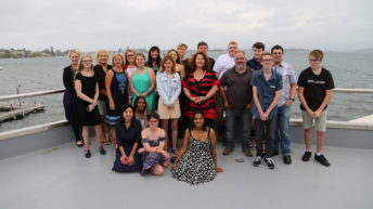 Newcastle Ignition Mentoring Program Mentors and Mentees with a beautiful harbour view behind them