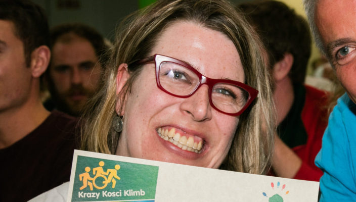 Johanna Garvin holding up her Krazy Kosci Klimb certificate after participating in the event