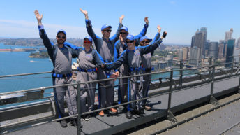 Andrew West with Cerebral Palsy at the top of the Sydney Bridge Climb with his support crew.