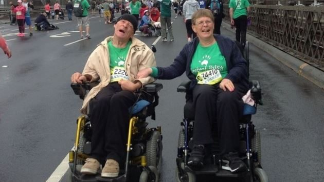 Couple with cerebral palsy, Lindsay and maria, in their wheelchairs participating in a fun run event.