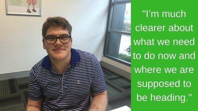 A photo of a young man with cerebral palsy sitting in a meeting room. Includes a quote: