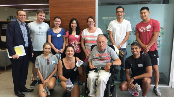 A group of volunteers with a Cerebral Palsy Alliance client