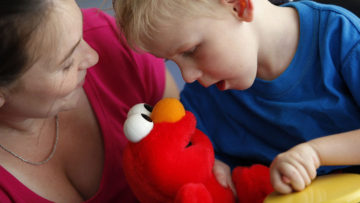 Boy with switch and Elmo toy
