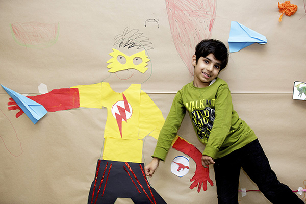 One boy posing with an artwork
