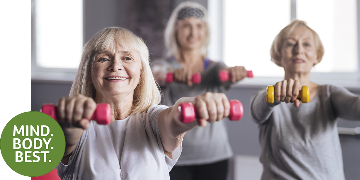 Three ladies lifting weights