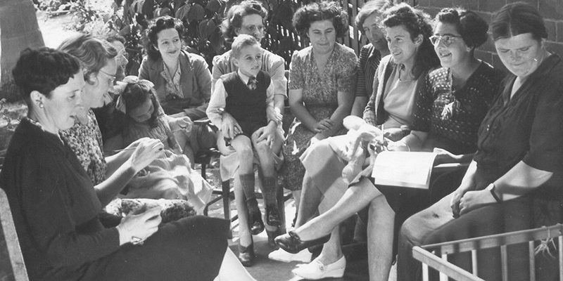 First mothers meeting. Black and white photo with a group of mothers