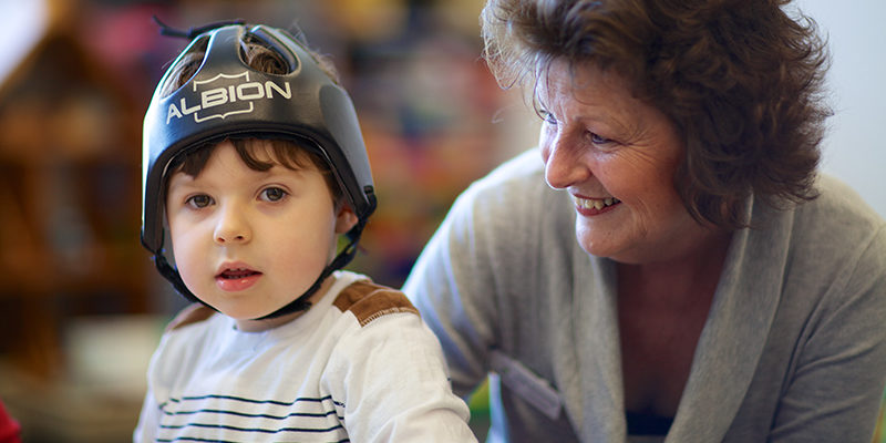 Vicki, individual volunteer with a little boy