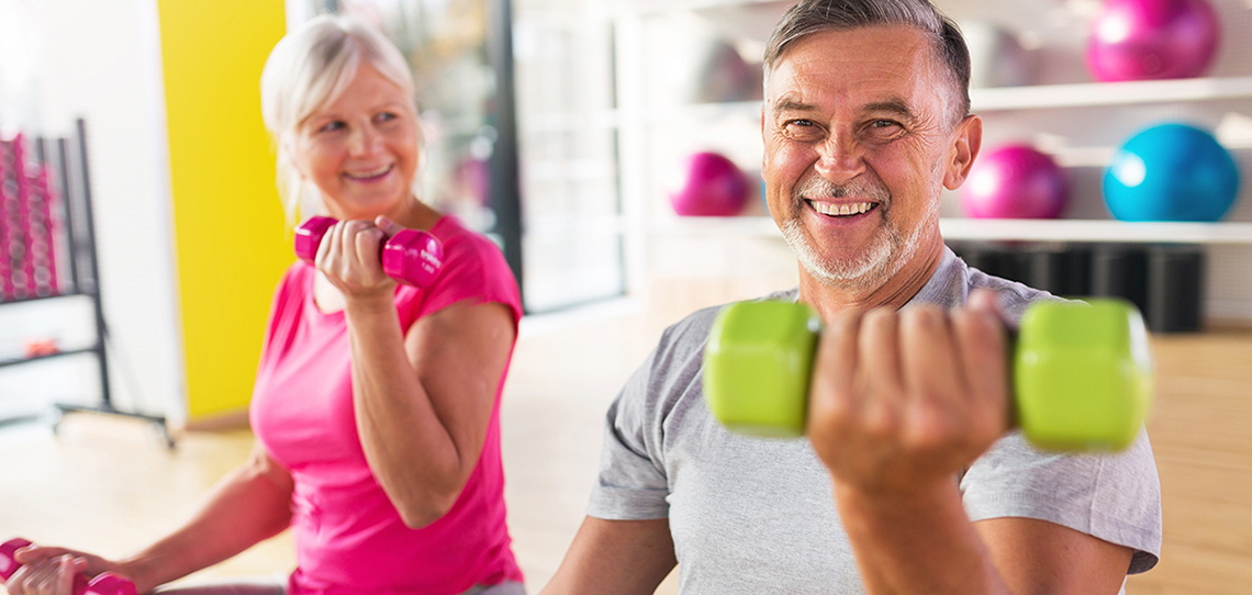 Senior couple lifting dumbbells