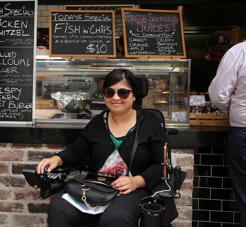 Teenage girl in a wheel chair visiting a cafe